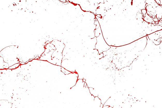 Respingo de tinta vermelha isolado no fundo branco.