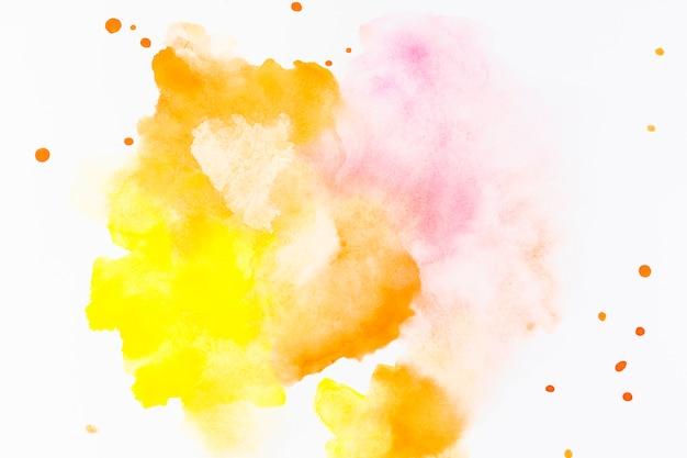 Respingo e gotas de tinta amarela
