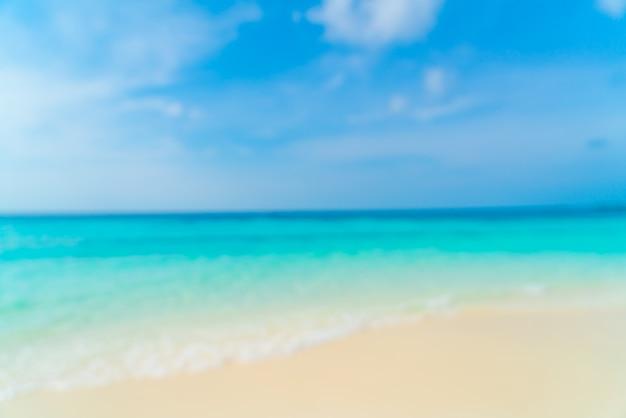 Resumo blur mar praia tropical e céu azul para plano de fundo