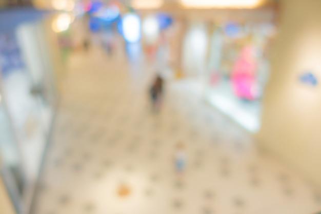 Resumo blur pessoas no centro comercial.