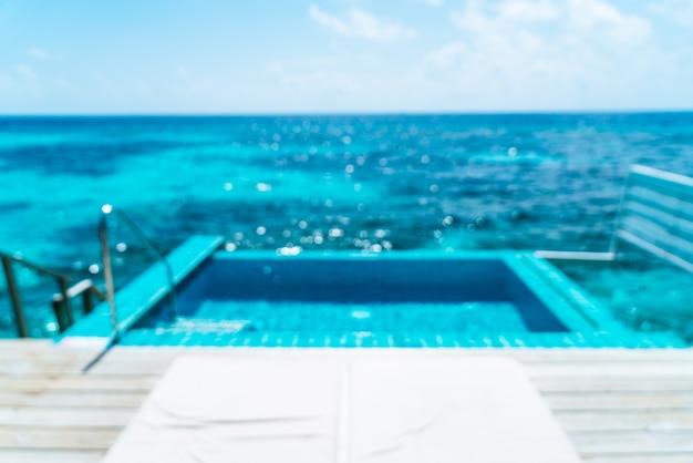 Resumo blur piscina e mar fundo nas maldivas