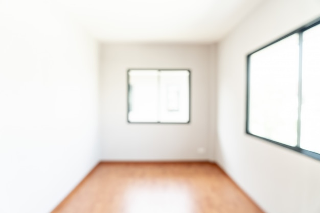 Resumo blur quarto vazio com janela e porta em casa