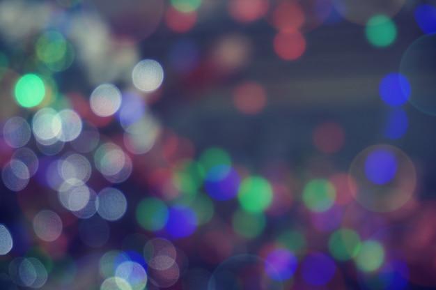 Resumo bokeh glitter vintage lights. natal bokeh luz defocused fundo abstrato. pode ser usado textura de papel de parede com área de espaço de cópia para um texto