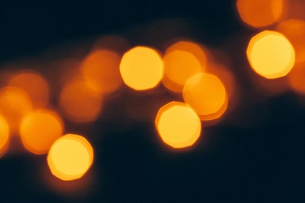 Resumo bokeh ouro brilho em fundo escuro