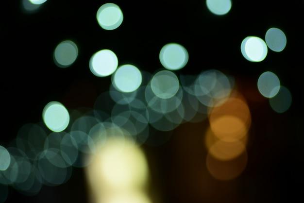 Resumo borrado de azul e prata brilhante brilho lâmpadas luzes fundo