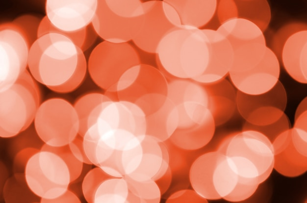 Resumo borrado de vermelho brilhante brilho lâmpadas luzes fundo