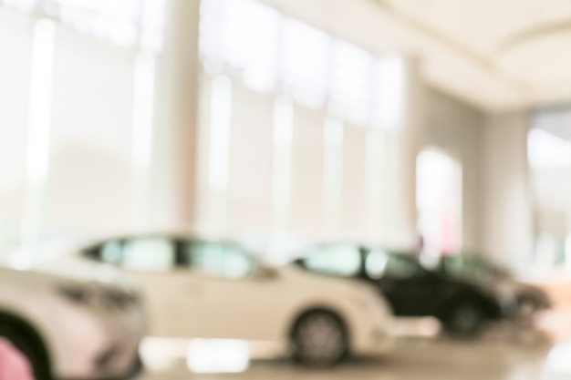 Resumo borrão de carro no fundo da sala de exposições