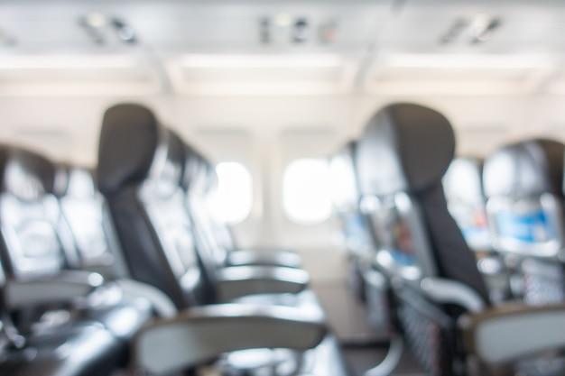 Resumo borrão e assento desfocado no interior do avião