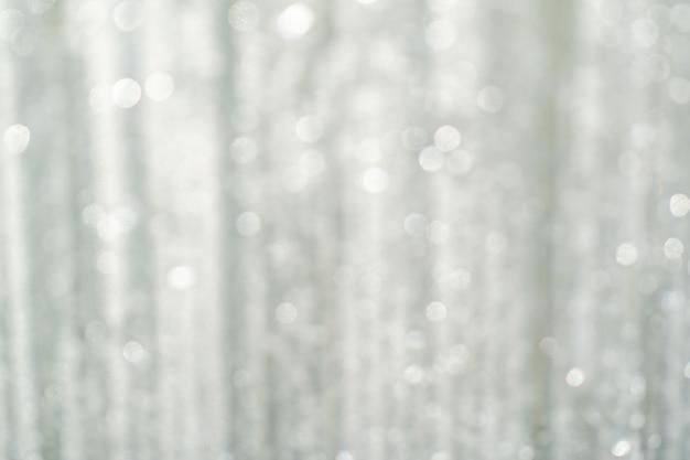 Resumo com luz branca turva, branco e prata