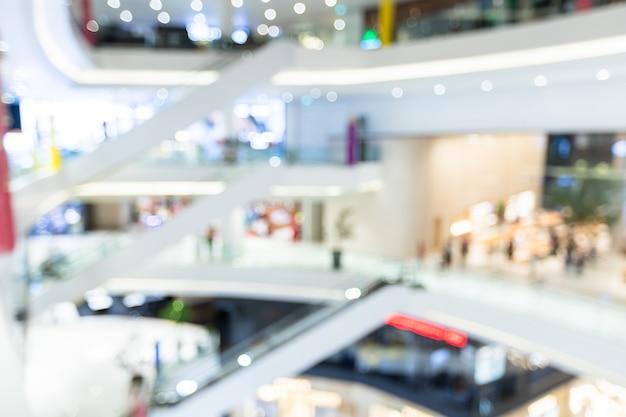 Resumo de bokeh desfocando a luz do interior do shopping center