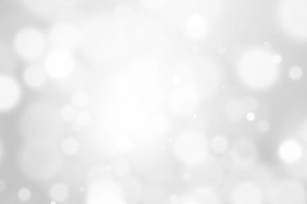 Resumo de bokeh turva prata e branco fundo bonito. brilho de luz de cor suave brilha.