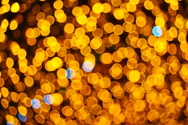 Resumo de cor laranja de borrão e bokeh colorido luz e noite jardim
