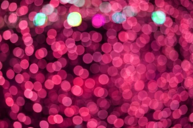 Resumo de cor rosa de borrão e bokeh colorido luz e noite jardim