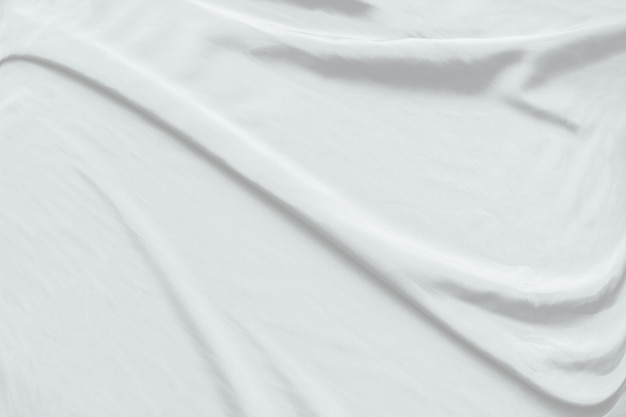 Resumo de fundo de pano branco com ondas suaves.