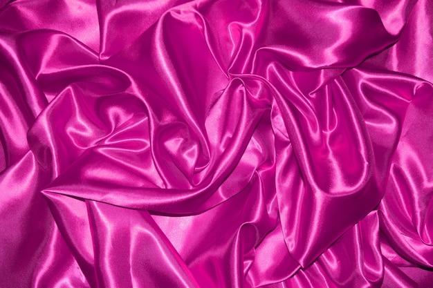 Resumo de fundo de pano rosa com ondas suaves