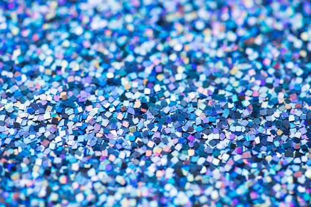 Resumo de plano de fundo texturizado glitter azul lantejoulas