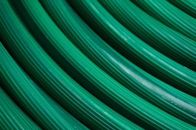 Resumo de tubo de borracha verde textura para regar plantas no jardim