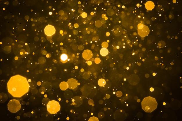 Resumo desfocar o fundo de bokeh de brilho de ouro