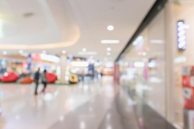 Resumo desfocar o fundo desfocado do interior do shopping moderno