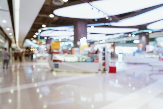 Resumo desfocar shopping de luxo e loja de varejo para mesa