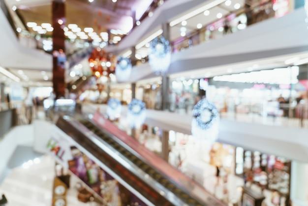 Resumo desfocar shopping de luxo e loja de varejo para segundo plano