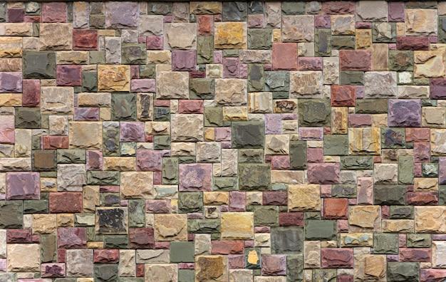 Retalhos coloridos do fundo da telha da textura da pedra da parede da arenito, marrons
