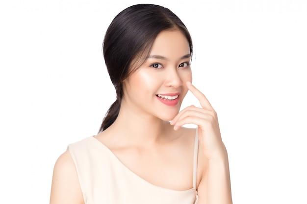 Retrato bela jovem mulher asiática, apontando o nariz