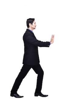 Retrato, de, asiático, homem negócios, empurrar, algo