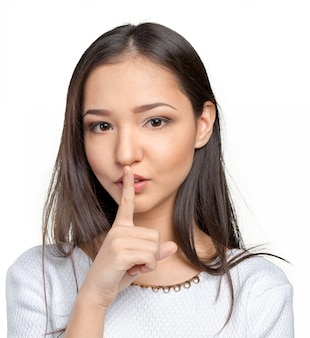 Retrato, de, atraente, menina adolescente, com, dedo, ligado, lábios
