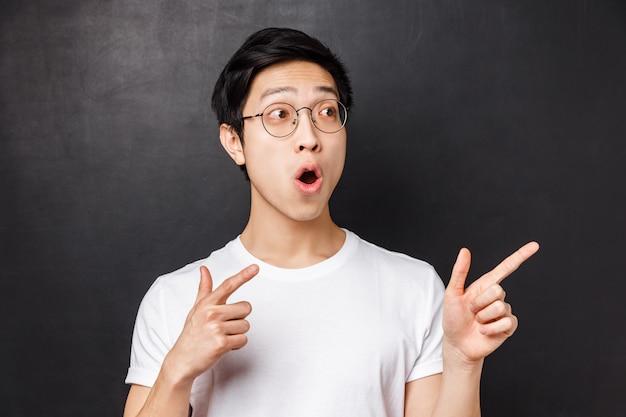 Retrato de close-up de curioso e animado, entusiasmado rapaz asiático visitar exposição legal