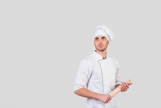 Retrato, de, cozinheiro chefe, com, alfinete rolante
