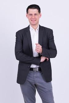 Retrato de empresário bonito vestindo terno branco