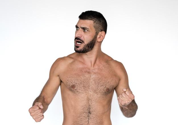 Retrato de estúdio de peito nu homem oriente médio