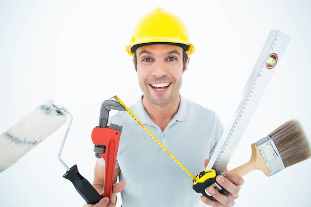 Retrato, de, feliz, trabalhador, segurando, vário, equipamento