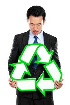 Retrato, de, homem negócios, segurando, sinal reciclar