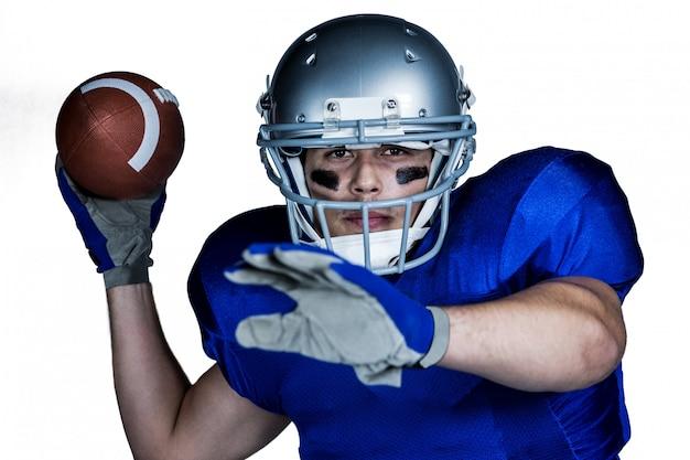 Retrato, de, jogador football americano, com, bola jogando