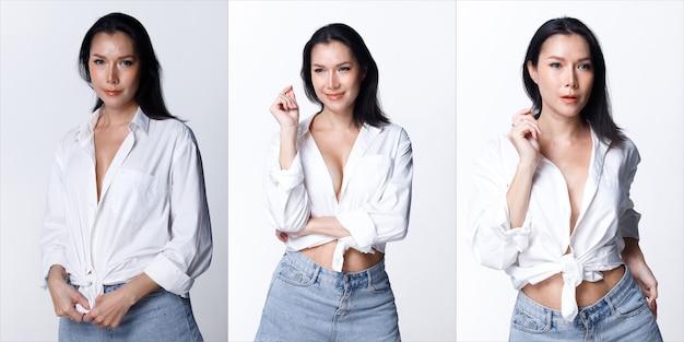 Retrato de meio corpo dos anos 40 asiático lgbtqia + mulher, cabelo preto, vasta calça jeans branca. mulher transgênero dos anos 30 expressa sentindo-se feliz, sorriso, muitas poses, sobre o branco.