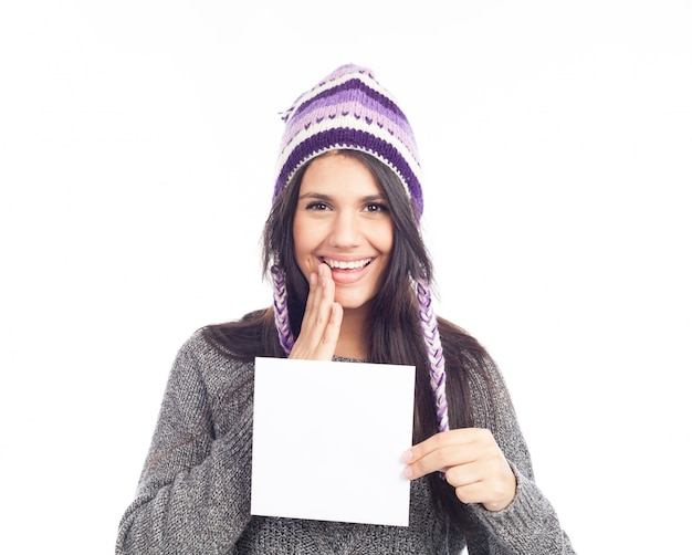 Retrato, de, mulher jovem, com, um, suéter, e, peruvian, chapéu, woolen, segurando, sinal, cartão