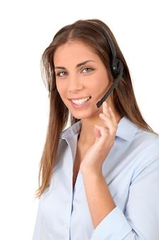 Retrato, de, mulher sorridente, com, headset, ligado