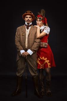 Retrato, de, steampunk, menina, e, homem, em, óculos, e, cana