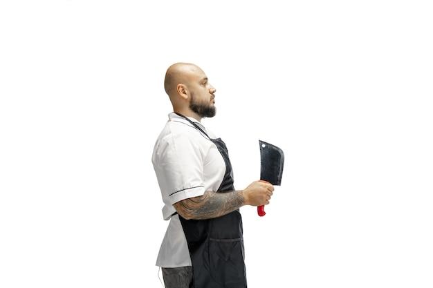 Retrato de um cozinheiro chefe masculino isolado em um fundo branco de estúdio