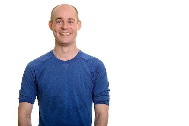 Retrato de um homem branco careca feliz sorrindo