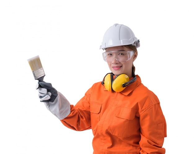 Retrato, de, um, trabalhador mulher, em, mecânico, jumpsuit, é, segurando, pintar escova