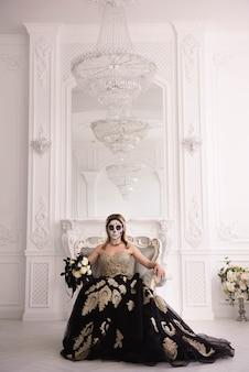 Retrato de uma mulher com uma caveira feita para o halloween