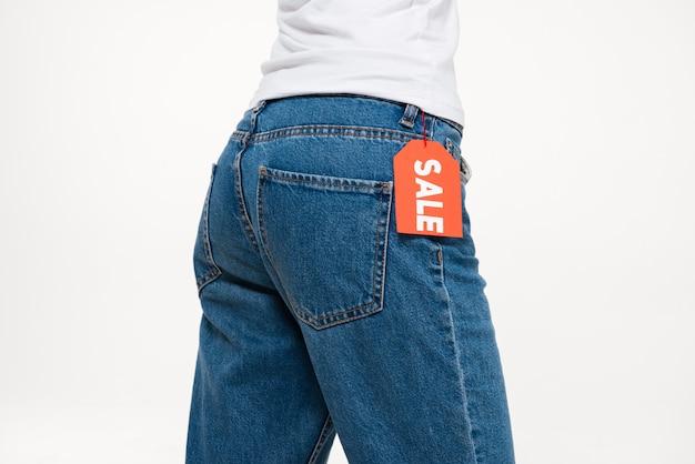 Retrato de uma nádegas femininas em jeans