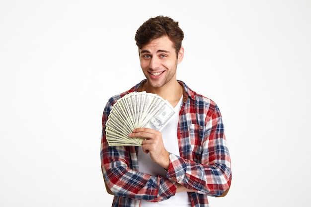 Retrato, jovem, homem, segurando, monte, dinheiro, notas