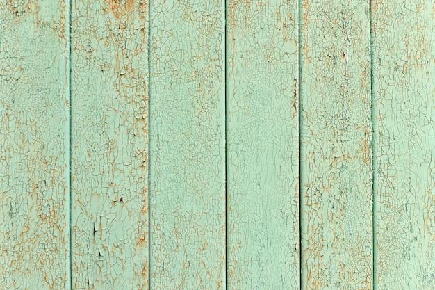 Ripas verticais, tinta verde velha e rachada. fundo