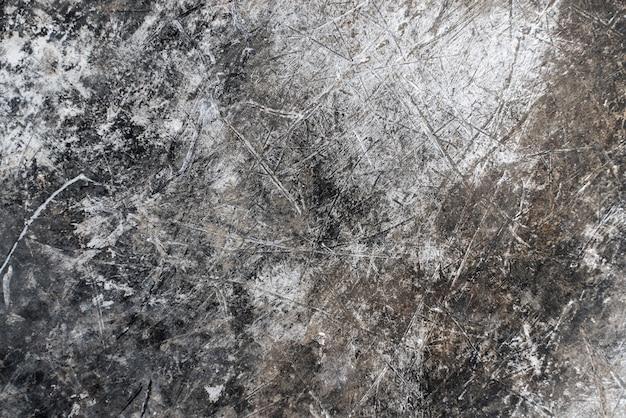 Riscado efeito de metal cromo comprimido fundo. painel de superfície industrial cinza de textura danificada. foto