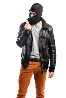 Robber fazendo um gesto de dinheiro