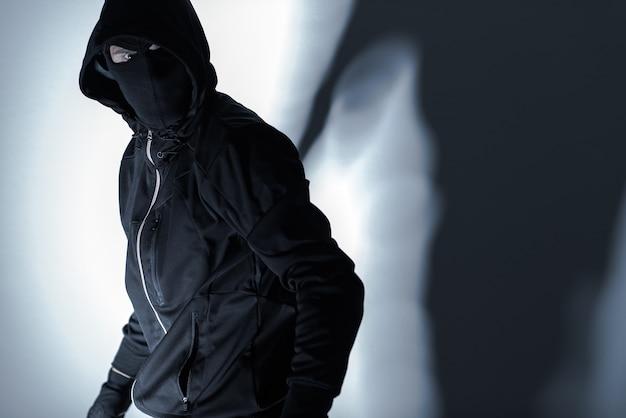 Robber in black mask